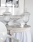 Glass bonbonniere jars on Rococo console table
