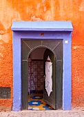 Colourful house entrance with open door (Morocco)