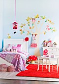Little girl's room with a stylized tree painting on the wall