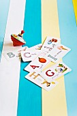 Top and alphabet cards on a wooden crate painted with a variety of colors