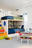 Cozy and colorful drawer stair bunk beds; child's name on the safety rail
