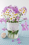 White and Purple Wild Flowers in a Vase with Ribbon