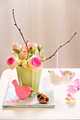 Vase of roses with Easter decorations