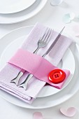 Ribbon napkin ring with oversize clown button decorating table