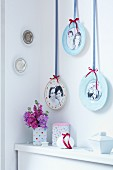 Gallery of photos on plates hung on wall by decorative ribbons