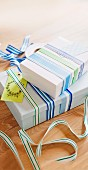 Gift boxes wrapped with various striped ribbons