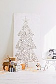Hand-crafted Christmas tree made from nails & thread on wooden panel