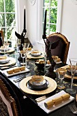 Elegant dining table set for Christmas in black and gold