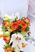Bridal bouquet with roses and lilies