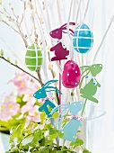 Easter decorations hanging from twigs in flower pot