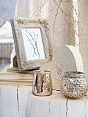 Silver tealight holders and picture frame on whitewashed tree stumps