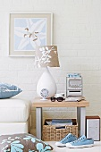White table lamp with print lampshade on side table