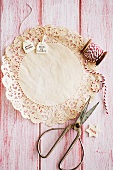 Doily, gift tags, red and white cord and scissors