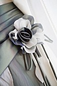 Grey and white fabric flower