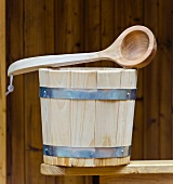 Wooden water bucket and ladle for the sauna