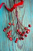 Rose hip branch with velvet ribbon