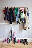 Cloak room with assorted jackets and shoes