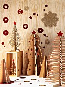 Artistic, plywood Christmas tree ornaments stabilised with red cord and decorated with red stars
