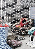 Mixture of patterns on lampshades, wallpaper, cushion covers and armchair upholstery