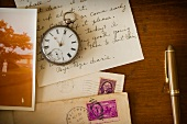 Still life with pocket watch, old letter and photograph