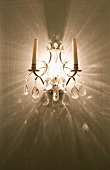 Crystal wall sconce with two candles
