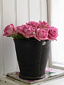 Pink roses in a pail