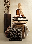 An African feel: cushions in shades of brown and a floor vase holding liana wood