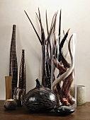Vases and tea light holders in shades of brown and glass vases with horns