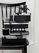 Black and white gift boxes with decorative ribbon on a black chair