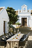 Festively set table in cobbled courtyard