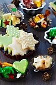 Small cake moulds used as dishes for biscuit, chocolates and festive confectionery