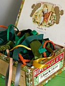 Colorful ribbons and cords in a vintage cigar box