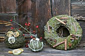 Festive, hand-crafted, scented balls and wreath of moss, wire and decorative natural items