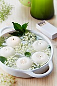 Bowl of floating candles and elderberry flowers