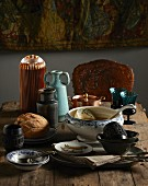 Winter shopping trends: soup tureen and bowls, vases, jugs and glasses on wooden table