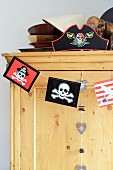 Wooden cupboard with pirate decoration
