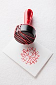 Rubber bands stretched around stamp handle to create graphic pattern