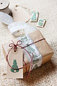 Present wrapped in brown paper decorated with tag and Easter stamp motifs