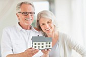 Older couple looking at model of house