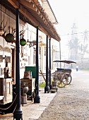 Antique facade of shop & lighthouse (Galle, Sri Lanka)