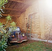 Rusty old classic car in shelter