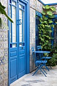 Wall of house with blue door & mosaic tiles (Sidi Bou Said, Tunisia)