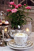 A table laid for coffee, with cakes and flowers