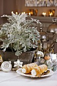 Cream-filled pastry horns on festively decorated table