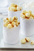 Paper muffin cases wrapped in lace trim as creative popcorn holders