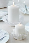 Crocheted doilies moulded into hand-crafted candle holders using fabric stiffener