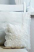 Cushion covers decorated with lace ribbon and crocheted doilies