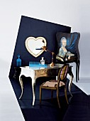 Baroque dressing table with modern plastic comb against dark blue, designer wall with heart-shaped mirror and Baroque portrait of woman; flooring continues into wall design
