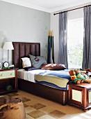 Brown bed with upholstered headboard in elegant, masculine bedroom
