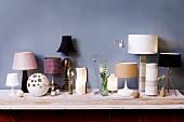 Various table lamps on chest of drawers